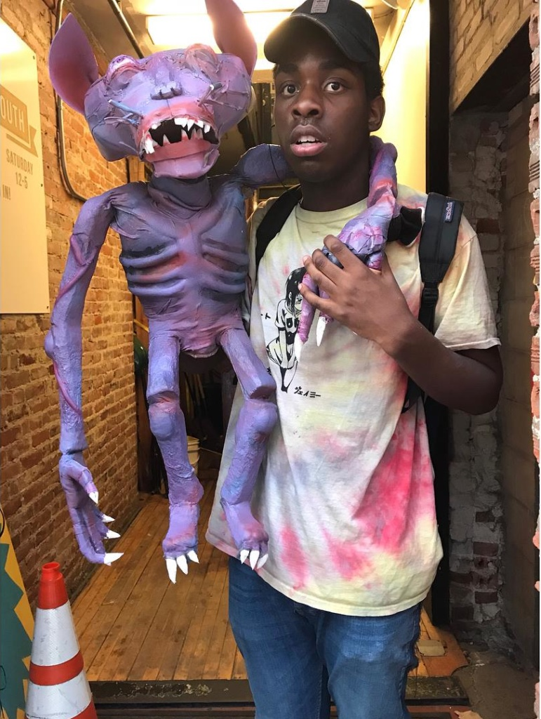 Desmond Andrews holding the puppet he built for FW4.