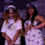 members modeling clothes designed and made by youth at Futureworlds runway show. photo by Allam Mella