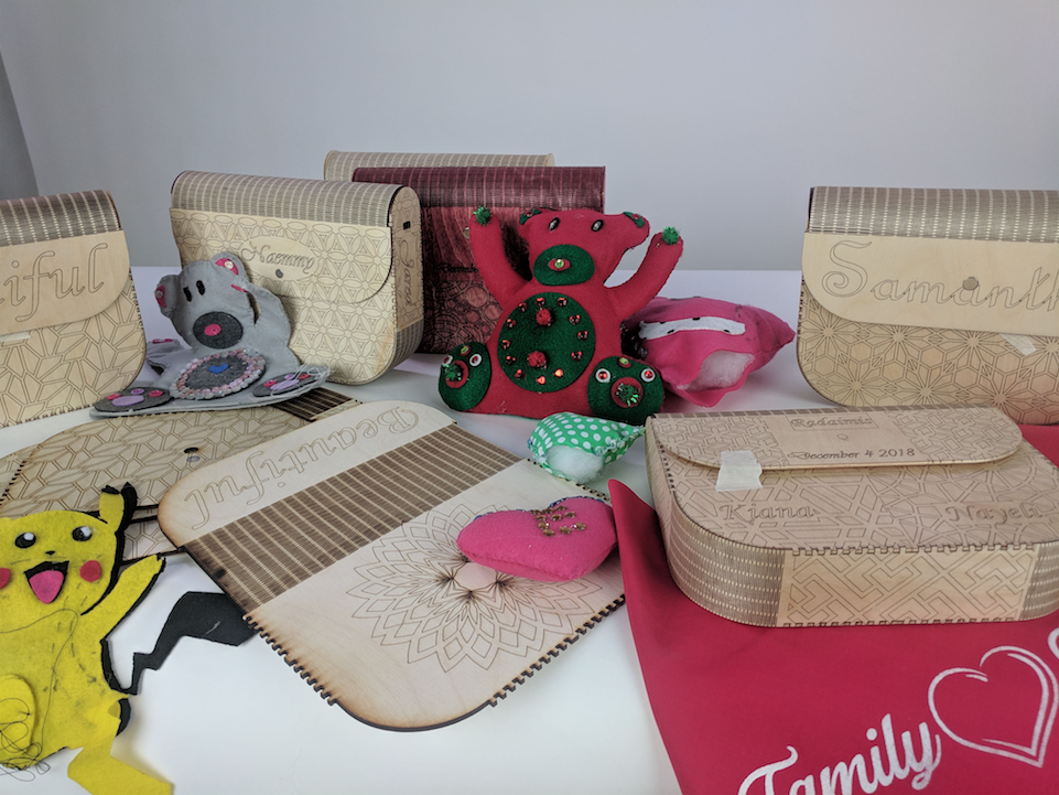 Laser cut purses and handmade dolls created by NLA students at AS220 Industries
