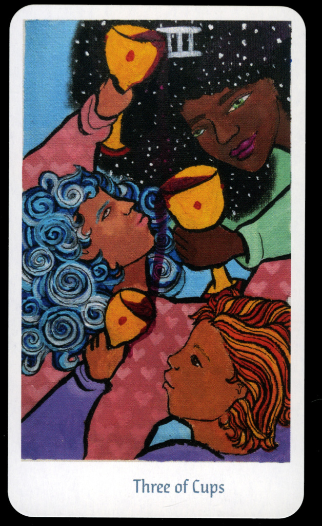 design for the three of cups tarot card. features the faces and hands of three black women holding gold goblets. each goblet pours liquid into the one below it. design by youth member ruby lopez